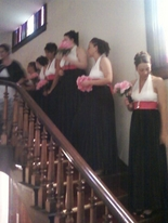 Hot pink Bridal party on the vintage double staircase at The Olde North wedding Chapel, richmond indiana wedding ceremony site.