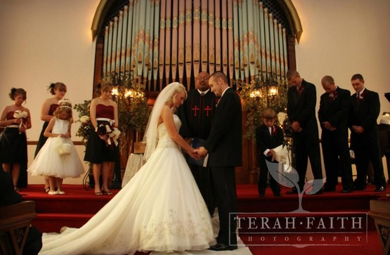 Historic Wedding chapel makes a perfect backdrop for this reverent moment during the ceremony, in Richmond, Indiana